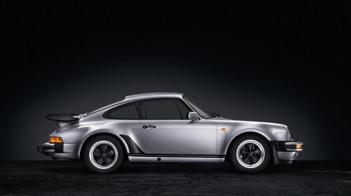 Silver Porsche Turbo In Front Of Black Background