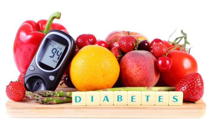 group of fruit together with a glucometer