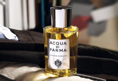 Aqua di Parma Men on a table with a men's suit jacket behind