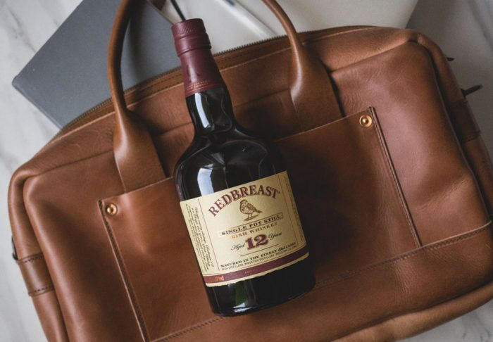 RedBreast Whiskey Bottle On A Messenger bag