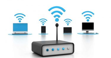 a router giving signal to a laptop, cellphone, table