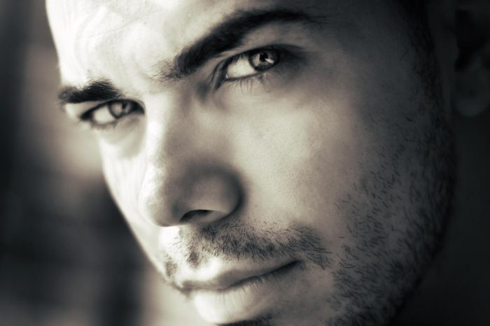 Face of man in black and white photo, Moreno with short beard, lashes and intense sensual look