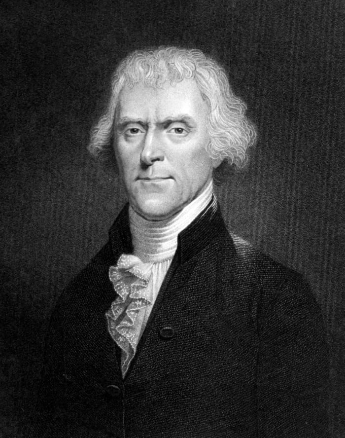 Thomas Jefferson in a pose with his peculiar white hair, wearing a black and white photo with big buttons with a turtleneck shirt and loops like a tie