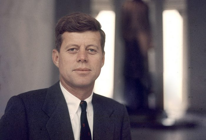 John F Kennedy in color photo, with his characteristic costume of the 1960s