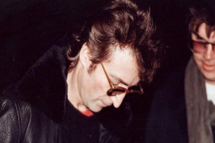 John Lennon signing autograph of his killer