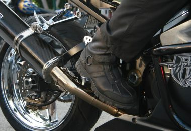 a man feet place in a motorcycle