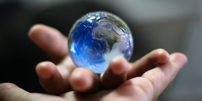 Marble looks like the earth in someone's hand